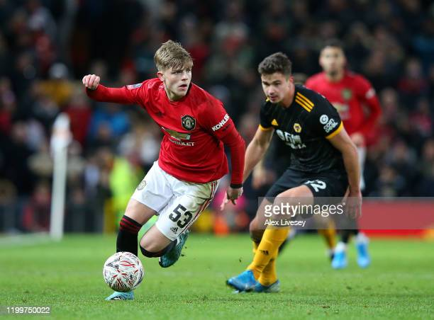 Brandon Williams of Manchester United runs with the ball during the FA Cup Third Round Replay match between Manchester United and Wolverhampton...