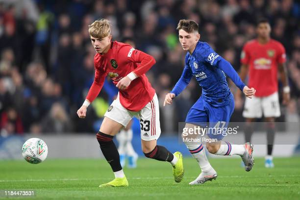 Brandon Williams of Manchester United runs with the ball under pressure by Billy Gilmour of Chelsea during the Carabao Cup Round of 16 match between...