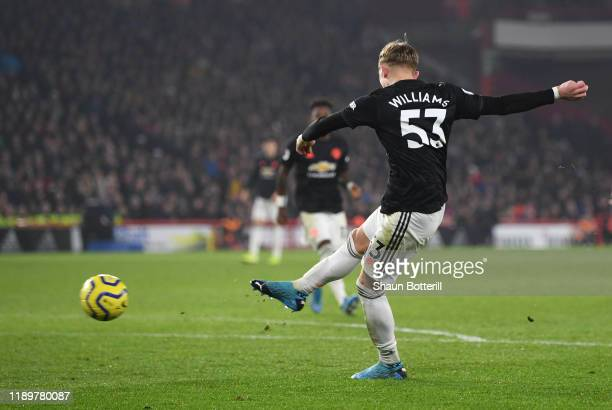 Brandon Williams of Manchester United scores his sides first goal during the Premier League match between Sheffield United and Manchester United at...