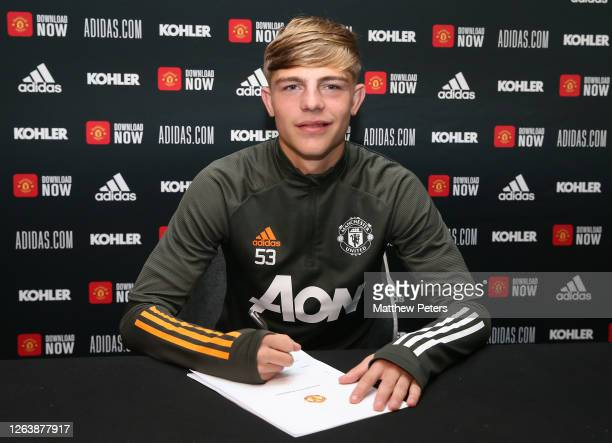 Brandon Williams of Manchester United signs a new contract with the club at Aon Training Complex on August 04, 2020 in Manchester, England.