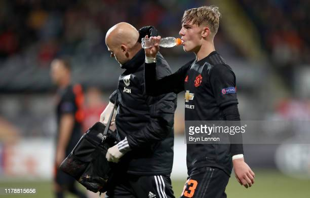 Brandon Williams of Manchester United takes a drink after receiving medical treatment during the UEFA Europa League group L match between AZ Alkmaar...