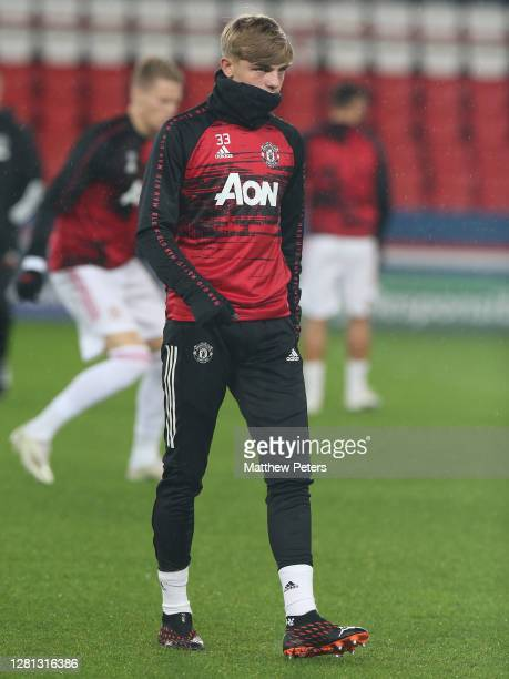 Brandon Williams of Manchester United warms up ahead of the UEFA Champions League Group H stage match between Paris SaintGermain and Manchester...