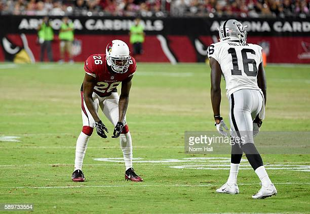 Brandon Williams of the Arizona Cardinals gets ready to defend against Johnny Holton of the Oakland Raiders at University of Phoenix Stadium on...
