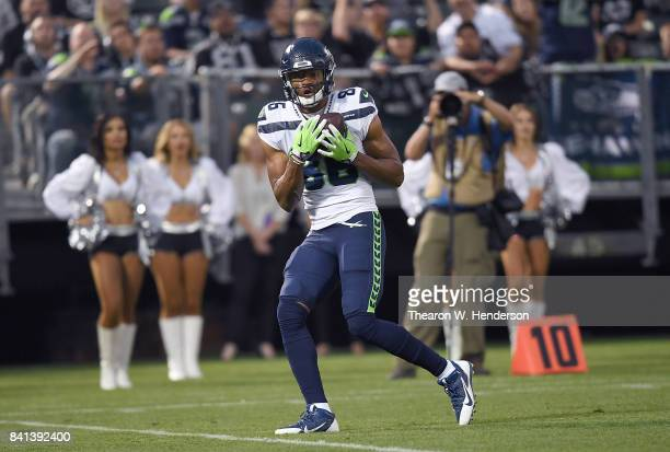 Brandon Williams of the Seattle Seahawks catches a touchdown pass against the Oakland Raiders during the first quarter of their game at the...