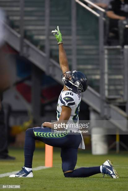 Brandon Williams of the Seattle Seahawks celebrates after scoring a touchdown against the Oakland Raiders during the first quarter of their game at...