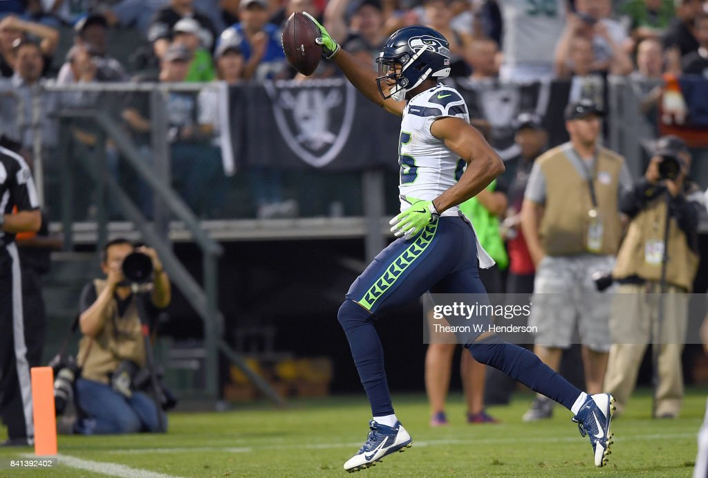 Brandon Williams #86 of the Seattle Seahawks scores a touchdown against the Oakland Raiders during the first quarter of their game at the Oakland-Alameda County Coliseum on August 31, 2017 in Oakland, California.