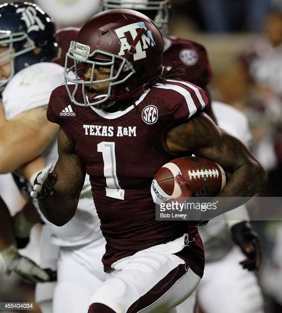 Brandon Williams of the Texas AM Aggies rushes with the ball in the second quarter against the Rice Owls at Kyle Field on September 13 2014 in...