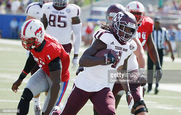 Brandon Williams of the Texas AM Aggies scores on a 10yard touchdown run past Jonathan Yenga of the Southern Methodist Mustangs in the first half of...