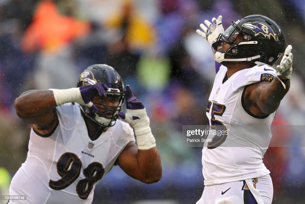 Brandon Williams #98 pretends to photograph teammate linebacker Terrell Suggs #55 of the Baltimore Ravens after his sack on quarterback Nathan Peterman #2 of the Buffalo Bills (not pictured) in the second quarter at M&T Bank Stadium on September 9, 2018 in Baltimore, Maryland.