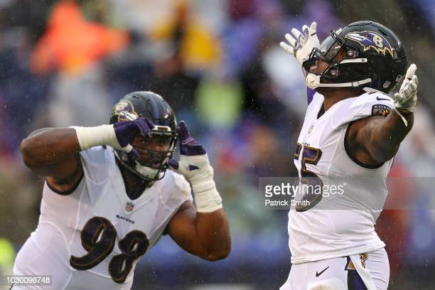 Brandon Williams pretends to photograph teammate linebacker Terrell Suggs of the Baltimore Ravens after his sack on quarterback Nathan Peterman of...
