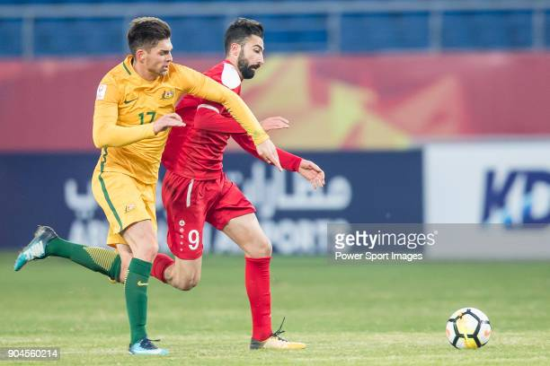 Brandon Wilson of Australia fights for the ball with Shadi Alhamwi of Syria during the AFC U23 Championship China 2018 Group D match between...