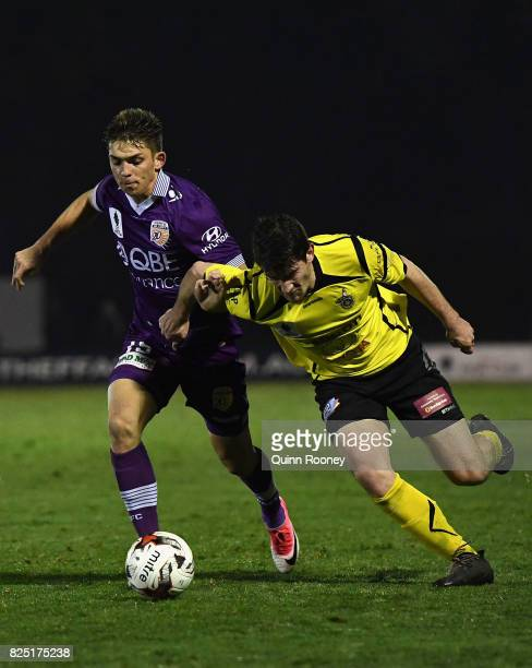 Brandon Wilson of Glory and Joshua Wilkins of United compete for the ball during the FFA Cup round of 32 match between Heidelberg United FC and Perth...