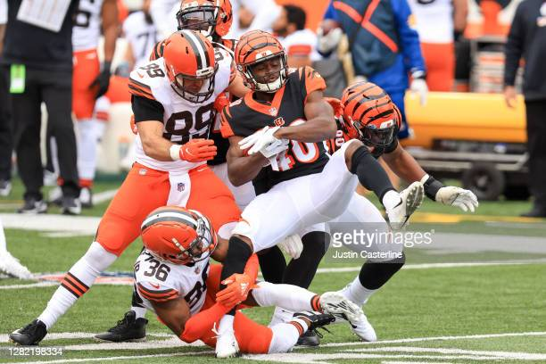 Brandon Wilson of the Cincinnati Bengals is tackled by Benny LeMay and Stephen Carlson of the Cleveland Browns at Paul Brown Stadium on October 25,...