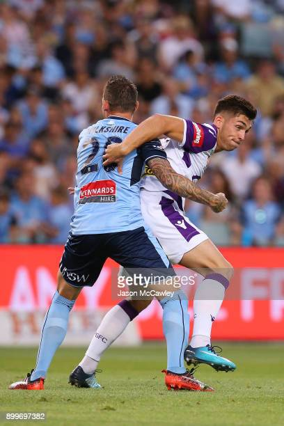 Brandon Wilson of the Glory is challenged by Luke Wilkshire of Sydney during the round 13 ALeague match between Sydney FC and Perth Glory at Allianz...