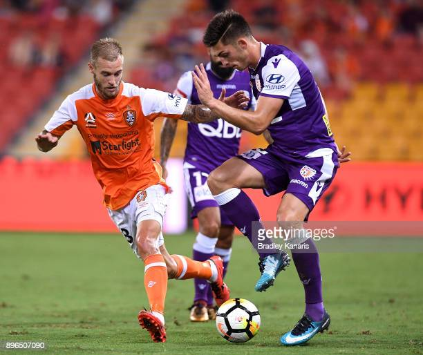 Brandon Wilson of the Glory takes on the defence during the round 11 ALeague match between the Brisbane Roar and the Perth Glory at Suncorp Stadium...