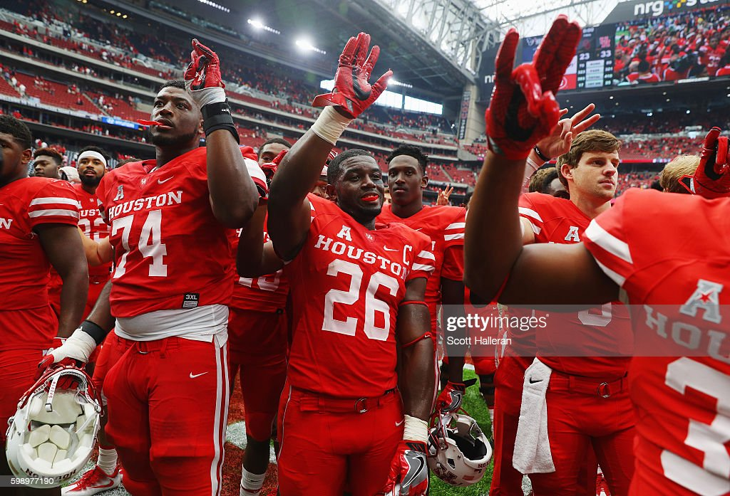 Brandon Wilson #26 of the Houston Cougars celebrates with his teammates after they defeated the Oklahoma Sooners 33-23 during the Advocare Texas Kickoff on September 3, 2016 in Houston, Texas.