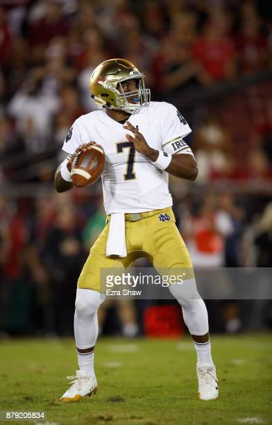 Brandon Wimbush of the Notre Dame Fighting Irish looks to pass the ball against the Stanford Cardinal at Stanford Stadium on November 25 2017 in Palo...