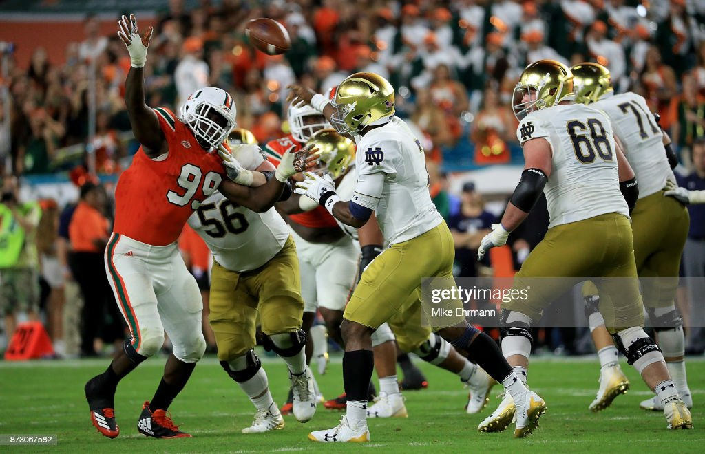 Brandon Wimbush #7 of the Notre Dame Fighting Irish passes over Joe Jackson #99 of the Miami Hurricanes during a game at Hard Rock Stadium on November 11, 2017 in Miami Gardens, Florida.