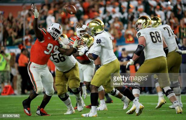Brandon Wimbush of the Notre Dame Fighting Irish passes over Joe Jackson of the Miami Hurricanes during a game at Hard Rock Stadium on November 11...