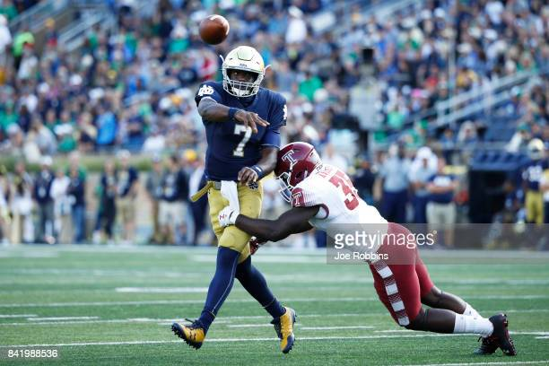 Brandon Wimbush of the Notre Dame Fighting Irish passes the ball in the fourth quarter of a game against the Temple Owls at Notre Dame Stadium on...
