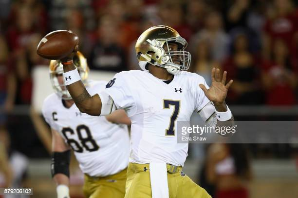 Brandon Wimbush of the Notre Dame Fighting Irish passes the ball against the Stanford Cardinal at Stanford Stadium on November 25 2017 in Palo Alto...