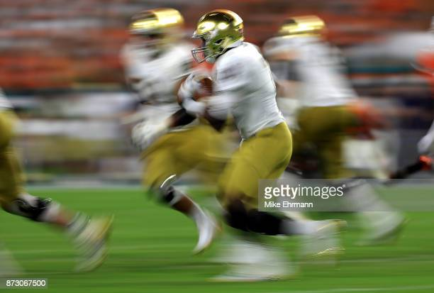 Brandon Wimbush of the Notre Dame Fighting Irish rushes during a game against the Miami Hurricanes at Hard Rock Stadium on November 11 2017 in Miami...