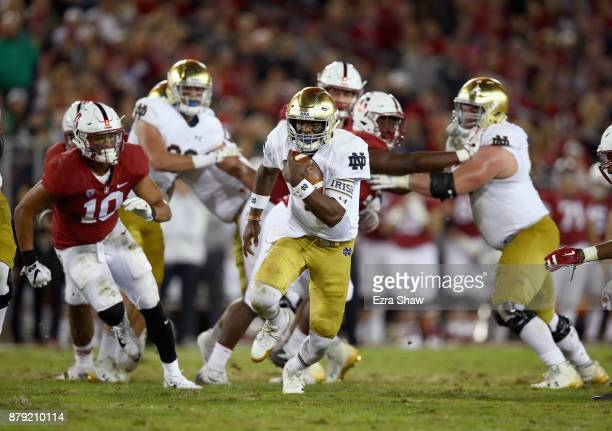 Brandon Wimbush of the Notre Dame Fighting Irish scrambles with the ball against the Stanford Cardinal at Stanford Stadium on November 25 2017 in...