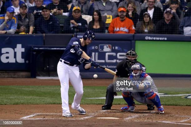 Brandon Woodruff of the Milwaukee Brewers hits a solo home run against Clayton Kershaw of the Los Angeles Dodgers during the third inning in Game One...