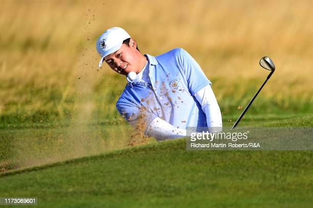 Brandon Wu of the United States plays a shot from the bunker on the fifth in the foursome matches during Day 2 of the Walker Cup at Royal Liverpool...