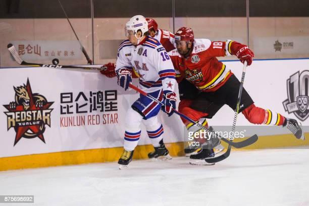 Brandon Yip of HC Kunlun Red Star and Sergei Plotnikov of SKA Saint Petersburg vie for the puck during the 2017/18 Kontinental Hockey League Regular...