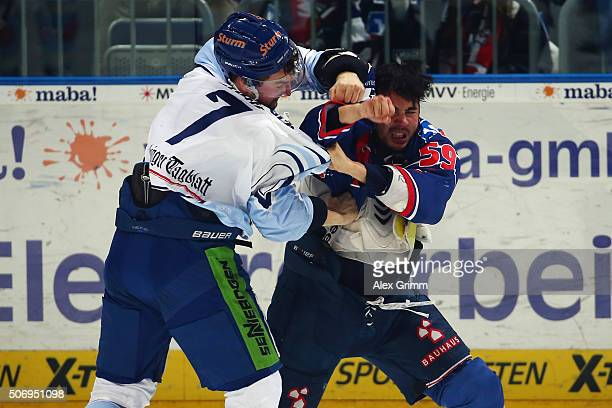 Brandon Yip of Mannheim fights with Colton Jobke of Straubing during the DEL match between Adler Mannheim and Straubing Tigers at SAP Arena on...
