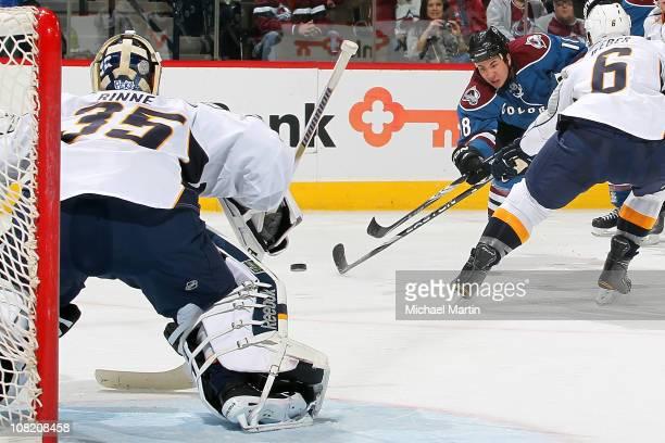 Brandon Yip of the Colorado Avalanche fires a shot on Nashville Predators goaltender Pekka Rinne as Shea Weber defends at the Pepsi Center on January...