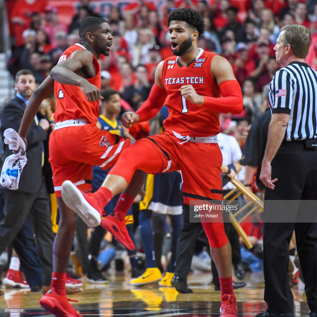 Brandone Francis #1 of the Texas Tech Red Raiders and Josh Webster #3 of the Texas Tech Red Raiders celebrate at a timeout during the game against the West Virginia Mountaineers on January 13, 2018 at United Supermarket Arena in Lubbock, Texas.