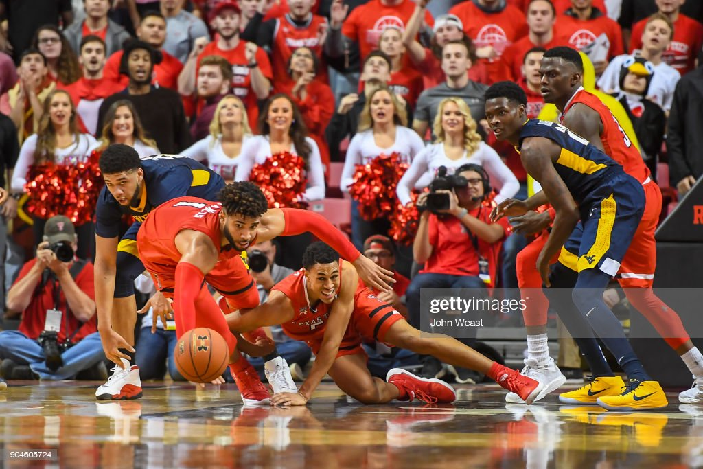 Brandone Francis #1 of the Texas Tech Red Raiders and Zhaire Smith #2 of the Texas Tech Red Raiders try and grab a loose ball during the game against the West Virginia Mountaineers on January 13, 2018 at United Supermarket Arena in Lubbock, Texas.
