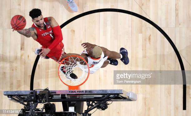 Brandone Francis of the Texas Tech Red Raiders attempts a shot against Mamadi Diakite of the Virginia Cavaliers in the first half during the 2019...