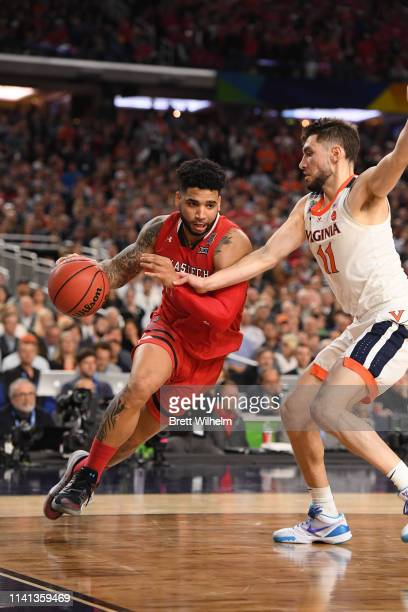 Brandone Francis of the Texas Tech Red Raiders drives against Ty Jerome of the Virginia Cavaliers during the second half in the 2019 NCAA men's Final...