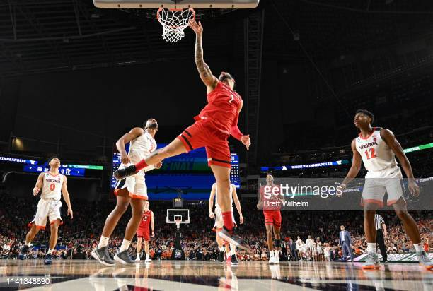 Brandone Francis of the Texas Tech Red Raiders drives to the basket against the Virginia Cavaliers during overtime of the 2019 NCAA men's Final Four...