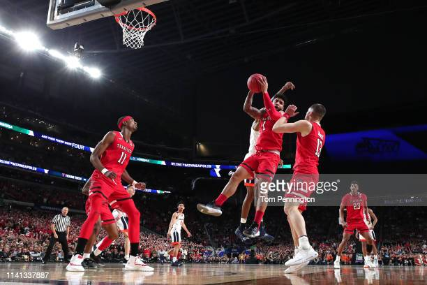 Brandone Francis of the Texas Tech Red Raiders grabs the rebound against the Virginia Cavaliers in the first half during the 2019 NCAA men's Final...