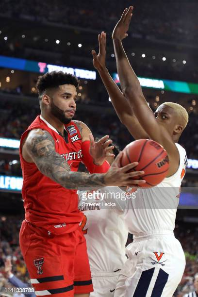 Brandone Francis of the Texas Tech Red Raiders is defended by Mamadi Diakite of the Virginia Cavaliers during the 2019 NCAA men's Final Four National...