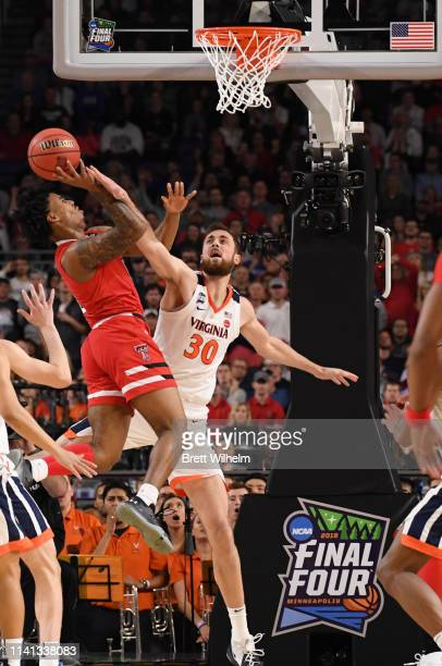 Brandone Francis of the Texas Tech Red Raiders is fouled by Jay Huff of the Virginia Cavaliers during the first half in the 2019 NCAA men's Final...