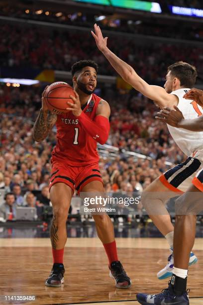 Brandone Francis of the Texas Tech Red Raiders shoots against Ty Jerome of the Virginia Cavaliers during the second half in the 2019 NCAA men's Final...