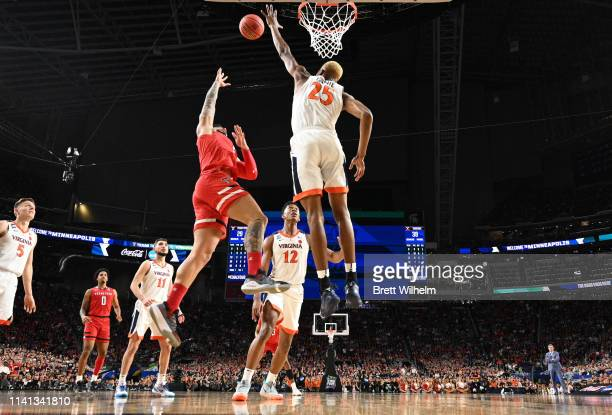 Brandone Francis of the Texas Tech Red Raiders shoots the ball over Mamadi Diakite of the Virginia Cavaliers during the second half of the 2019 NCAA...