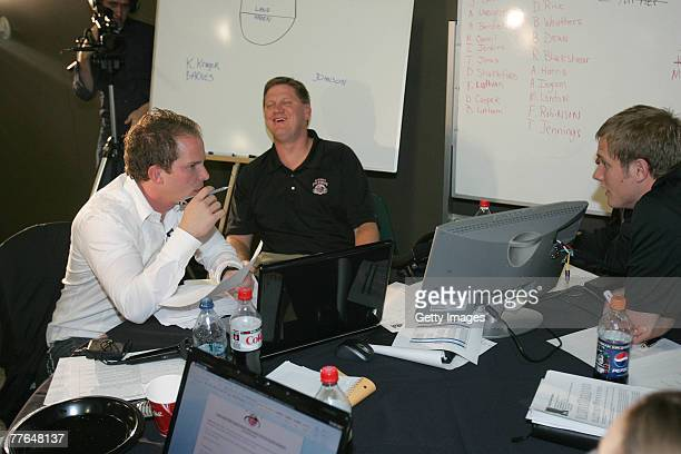 Brandt Andersen, owner of the Utah Flash basketball team, Brad Jones, Head Coach and Kevin Young, Director of Basketball Operations react to another...