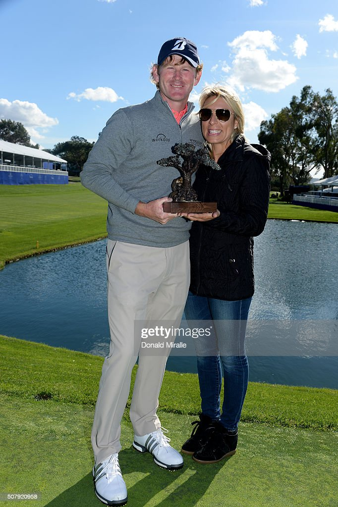 Brandt Snedeker (L) and wife Mandy pose with the winner's trophy after winning the Farmers Insurance Open at Torrey Pines South on February 1, 2016 in San Diego, California. Play was suspended due to inclement weather on Sunday.