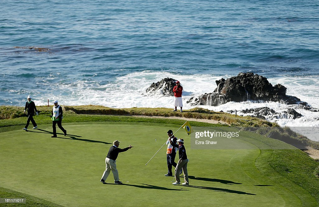 Brandt Snedeker celebrates a birdie on the seventh green with his playing partner Toby Witt during the third round of the AT&T Pebble Beach National Pro-Am at Pebble Beach Golf Links on February 9, 2013 in Pebble Beach, California.