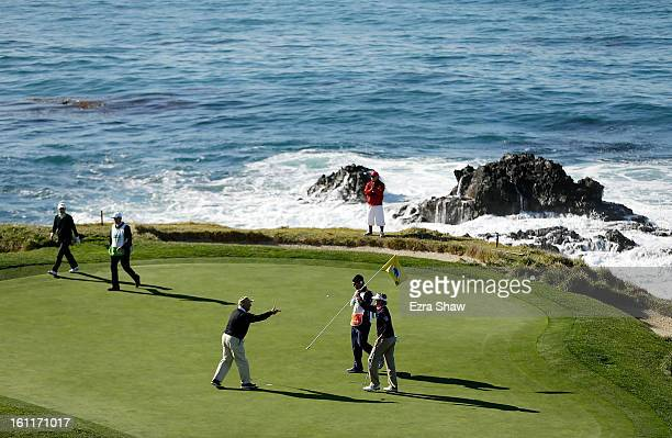 Brandt Snedeker celebrates a birdie on the seventh green with his playing partner Toby Witt during the third round of the ATT Pebble Beach National...