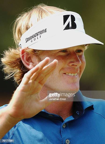 Brandt Snedeker celebrates a birdie putt on the 17th green during the final round of the Wyndham Championship at Forest Oaks Country Club on August...