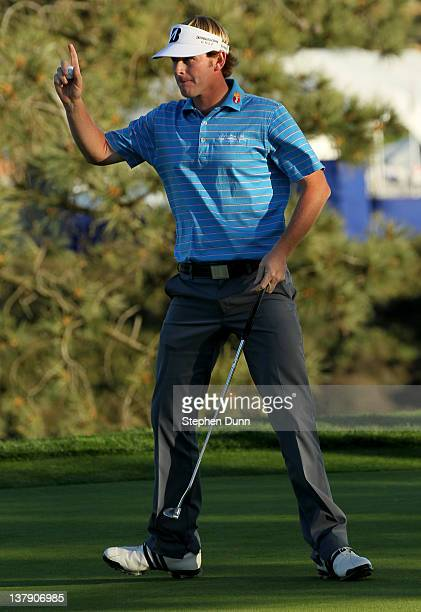 Brandt Snedeker celebrates after making a par putt which would win the second playoff hole and the championship during the final round of the Farmers...