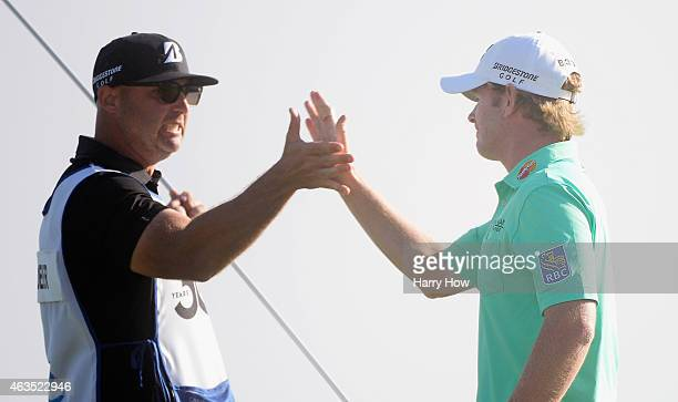 Brandt Snedeker celebrates his threestroke victory on the 18th green with his caddie Scott Vail during the final round at the ATT Pebble Beach...