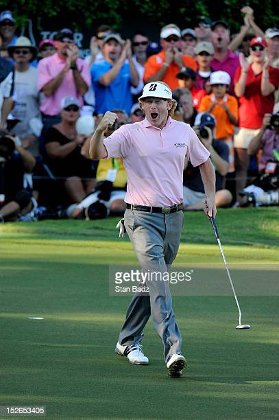 Brandt Snedeker celebrates on the 18th green after his three stroke victory during the final round of the TOUR Championship by CocaCola the final...